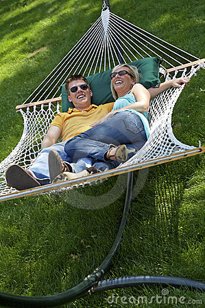 Couple in hammock laughing