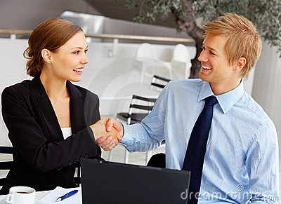 Couple Happily Shaking Hands And Smiling