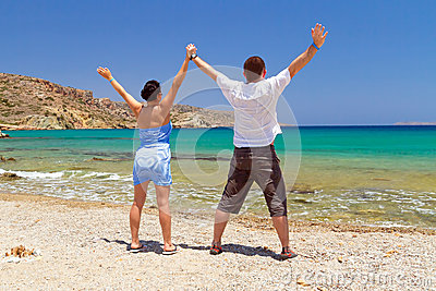 Couple in happiness at the sea