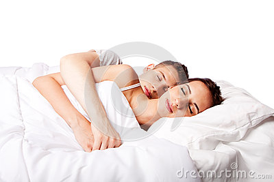 Couple happy asleep in bed