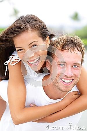 Couple happy having fun piggybacking