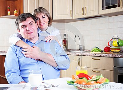Couple has breakfast together