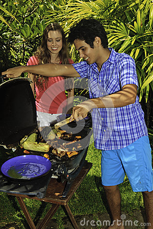 Couple having a barbeque