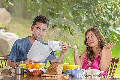 http://thumbs.dreamstime.com/x/couple-having-breakfast-fighting-over-bills-home-garden-background-32562917.jpg