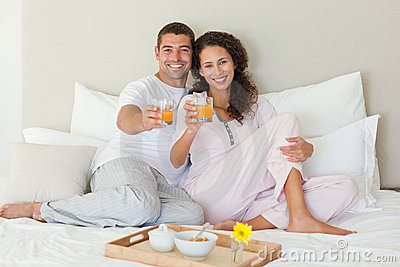 Couple having breakfast in their bed