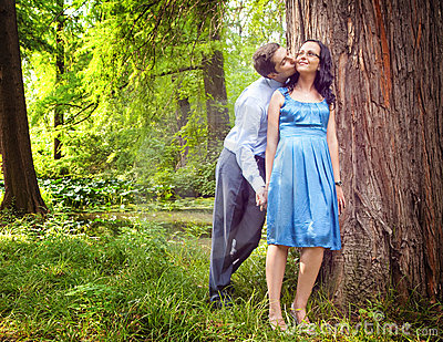 Couple having a candid romantic kiss outdoor