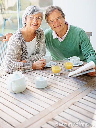 Couple having a casual talk at the breakfast table