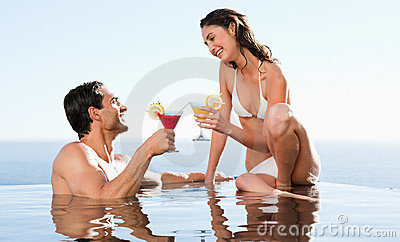 Couple having cocktails in the pool