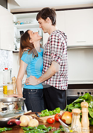 Couple having flirt at  kitchen