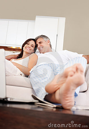Couple having free time together in living room