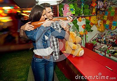 Couple having fun at amusement park