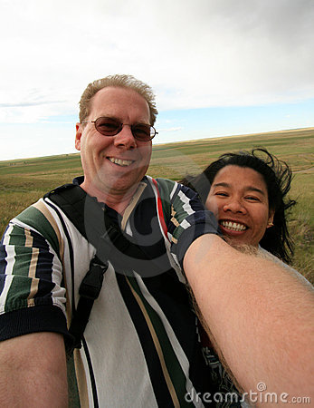 Couple Having Fun with Camera in Wind