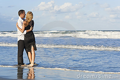 Couple Having Fun Embracing On A Beach