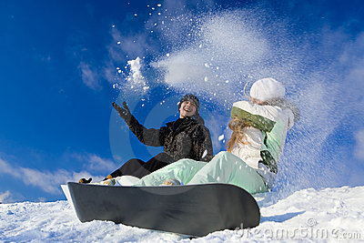 Couple having fun on snowboard