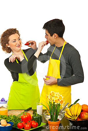 Couple having fun with strawberries