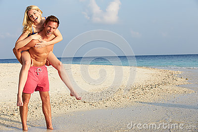 Couple Having Fun On Tropical Beach Holiday