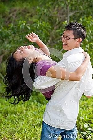 Couple having fun in the tropical garden