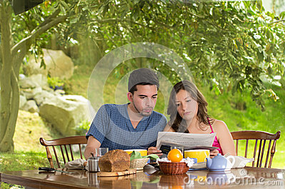 Couple having healthy breakfast at home, eating
