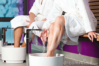Couple having hydrotherapy water footbath