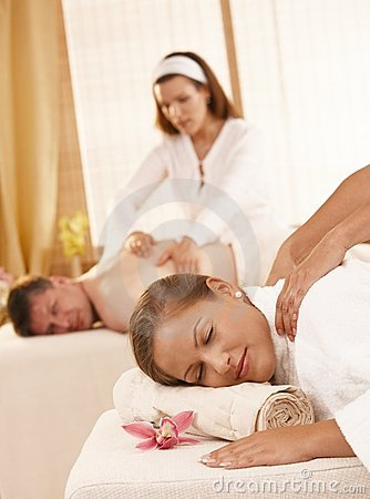 Couple having massage in spa