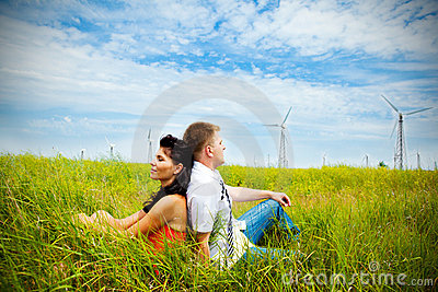 Couple having rest in the meadow