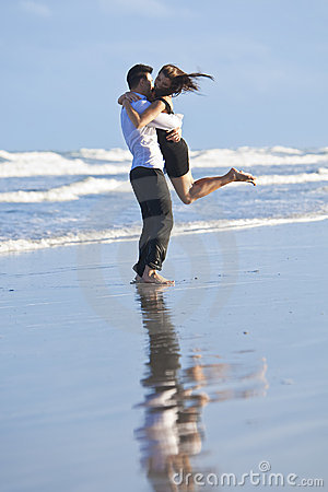 Couple Having In Romantic Embrace On Beach