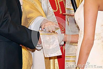Couple having their wedding ceremony in church.