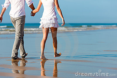 Couple having walk on the beach