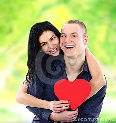 Couple with heart smiling outdoors