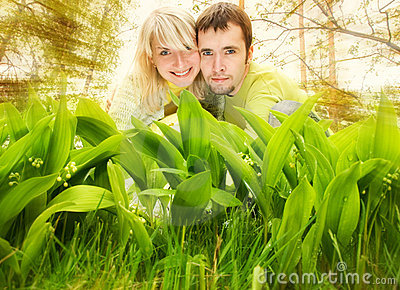 Couple hiding in a grass
