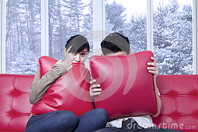 http://thumbs.dreamstime.com/x/couple-hiding-pillows-portrait-scared-watching-horror-movie-home-46844818.jpg