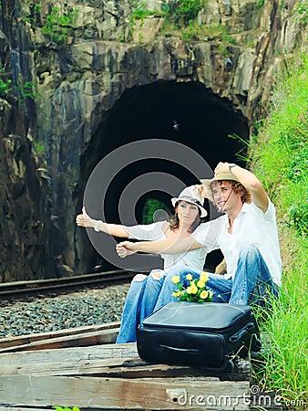 Couple hitch-hiking