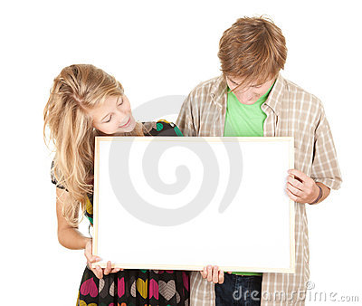 Couple holding blank billboard, poster
