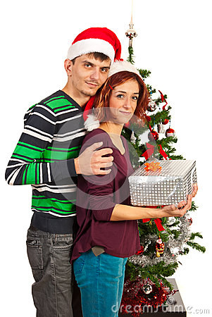 Couple holding Christmas present