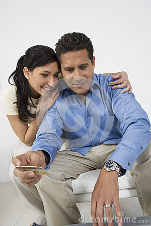 Couple Holding Credit Card