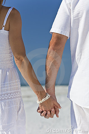 Couple Holding Hands on An Empty Beach