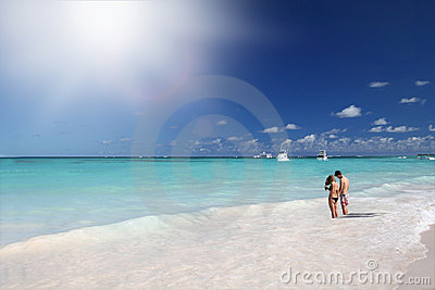 Couple Holding Hands on Tropical Beach in Ocean