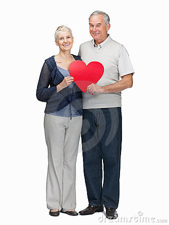 Couple holding a heart shaped board on white
