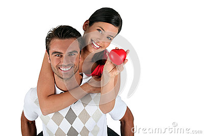 Couple holding heart-shaped object