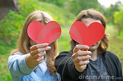 Couple holding hearts