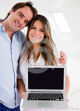 Couple holding a laptop