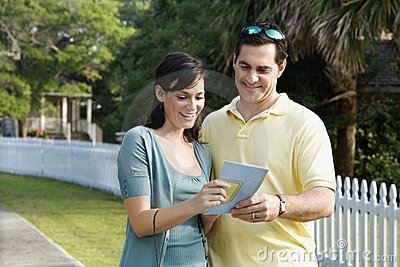Couple holding a map