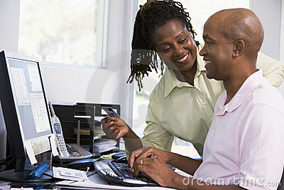 Couple in home office using computer