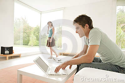 Couple at Home Using Technology