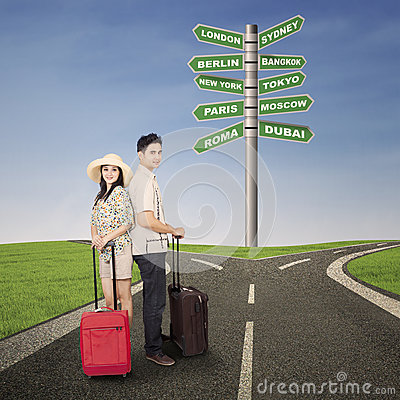 Couple honeymoon travel with luggages