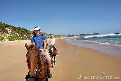 Couple of horse riders on beach