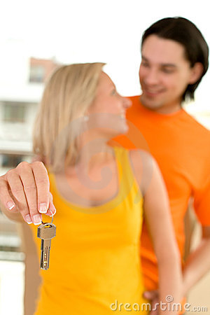 Couple with house keys
