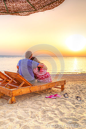 Couple in hug watching sunrise together
