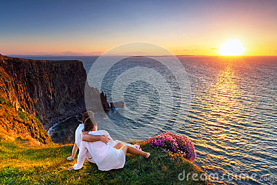 Couple in hug watching sunset