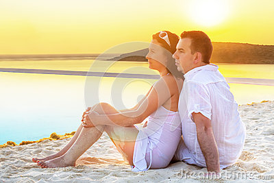 Couple in hug watching together sunrise